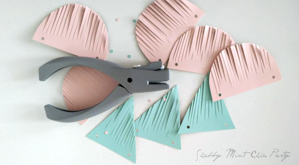 How to make buntings from free paint swatch samples from your paint or home improvement stores.