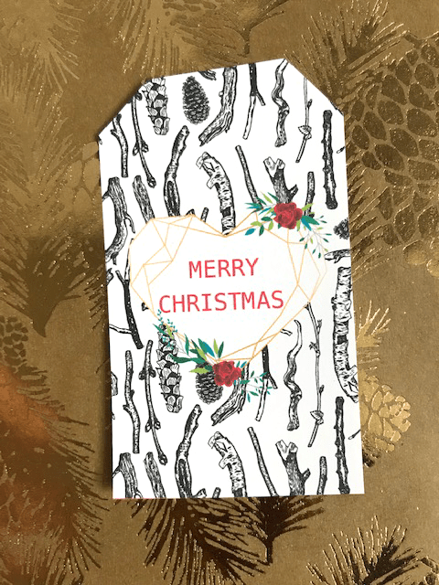 Beautiful Christmas gift tag. modern geometric hear with flowers and branch background.