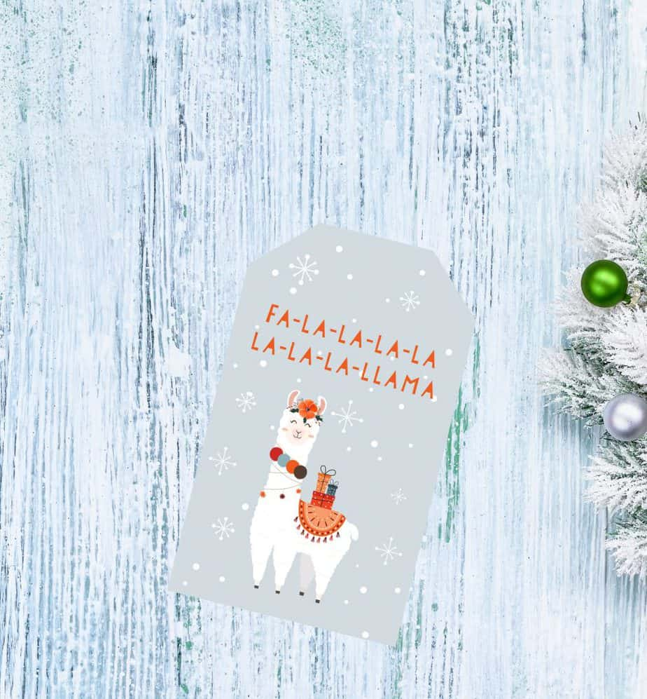 Christmas gift tags orange llama with wooden background