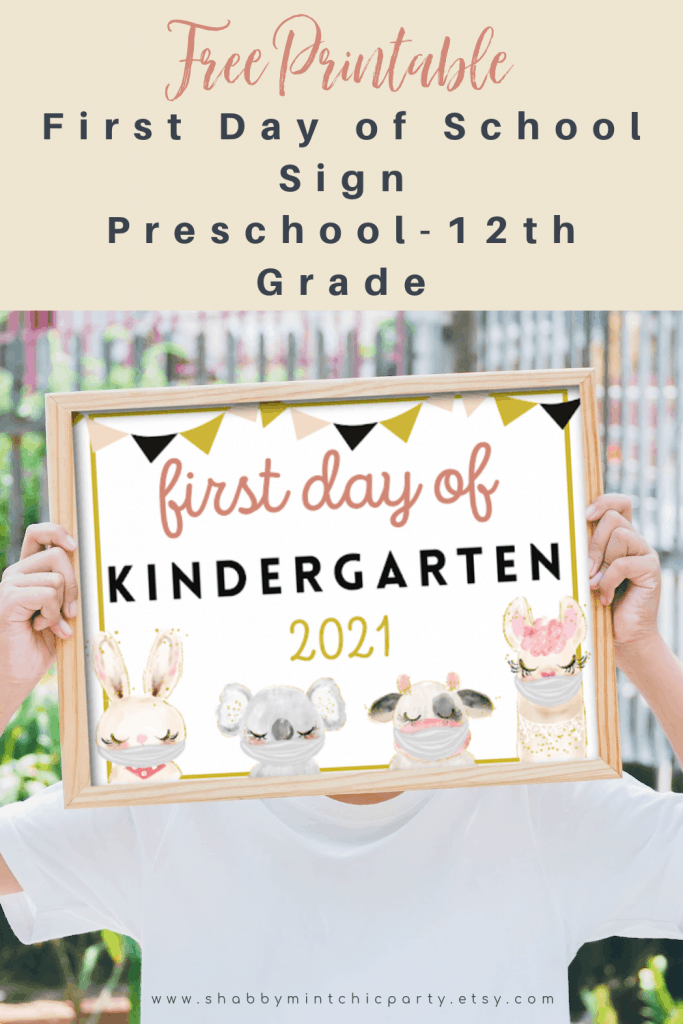 child holding First Day of School Sign- Animals with masks