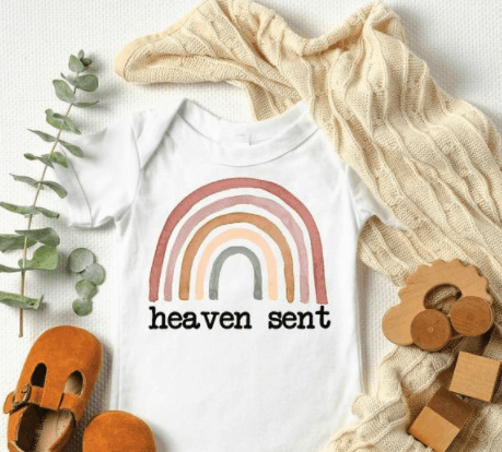 etsy boho rainbow body suit with the words heaven sent
