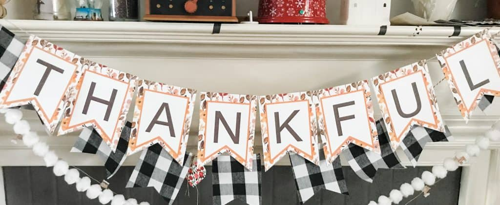 Thankful Thanksgiving banner over mantel
