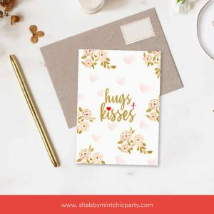 Free Printable Hugs and Kisses card on top of craft paper envelope mock up of greeting card