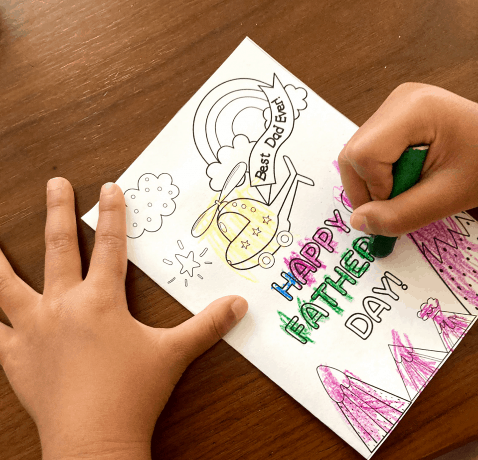 child coloring in father's day card